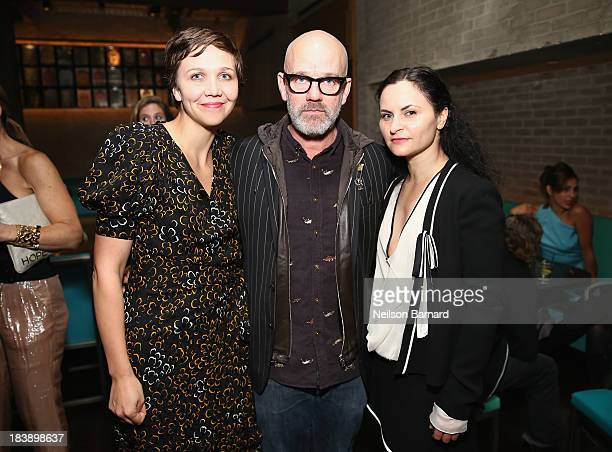 Maggie Gyllenhaal Michael Stipe and Rain Phoenix attend The Lunchbox Fund Fall Fête at Buddakan New York on October 9 2013 in New York City