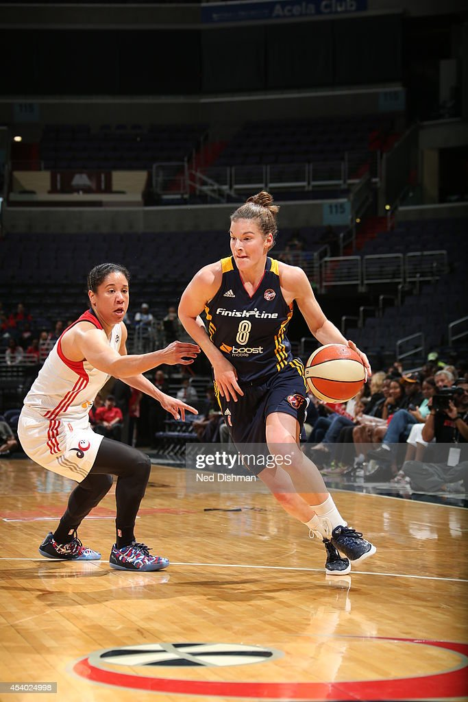 <a gi-track='captionPersonalityLinkClicked' href=/galleries/search?phrase=Maggie+Lucas&family=editorial&specificpeople=7449966 ng-click='$event.stopPropagation()'>Maggie Lucas</a> #8 of the Indiana Fever drives against Kara Lawson #20 of the Washington Mystics in Game Two of the Eastern Conference Semifinals during the 2014 WNBA Playoffs on August 23, 2014 at the Verizon Center in Washington, DC.