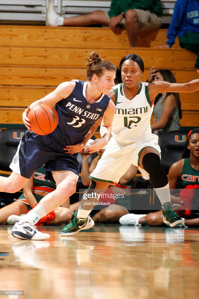 Maggie Lucas #33 of the Penn State Lady Lions dribbles the ball against Krystal Saunders #12 of the Miami Hurricanes on November 29, 2012 at the BankUnited Center in Coral Gables, Florida. Miami defeated Penn State 69-65.