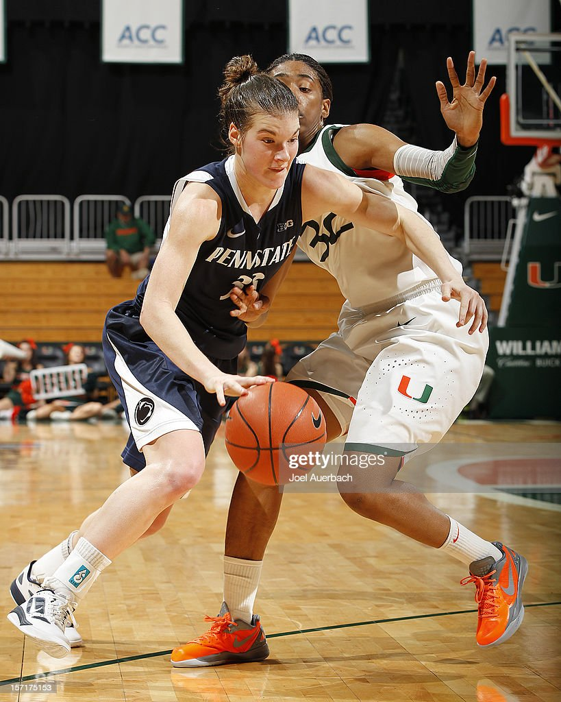 Maggie Lucas #33 of the Penn State Lady Lions drives to the basket past Morgan Stroman #32 of the Miami Hurricanes on November 29, 2012 at the BankUnited Center in Coral Gables, Florida. Miami defeated Penn State 69-65.