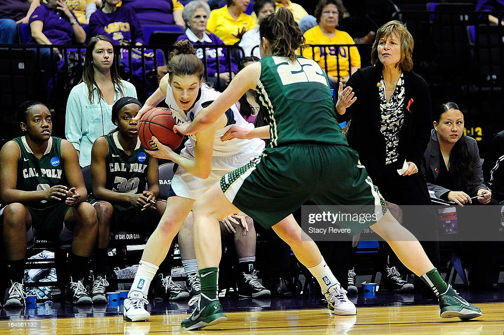 Maggie Lucas #33 of the Penn State Lady Lions is defended by Caroline Reeves #22 of the Cal Poly Mustangs during the first round of the NCAA Tournament at the Pete Maravich Assembly Center on March 24, 2013 in Baton Rouge, Louisiana.