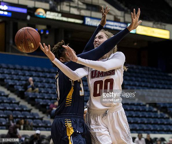 Maggie Mulligan of the Massachusetts Minutewomen attempts a shot against Ebony Wells of the La Salle Explorers on March 2 2016 at the Richmond...