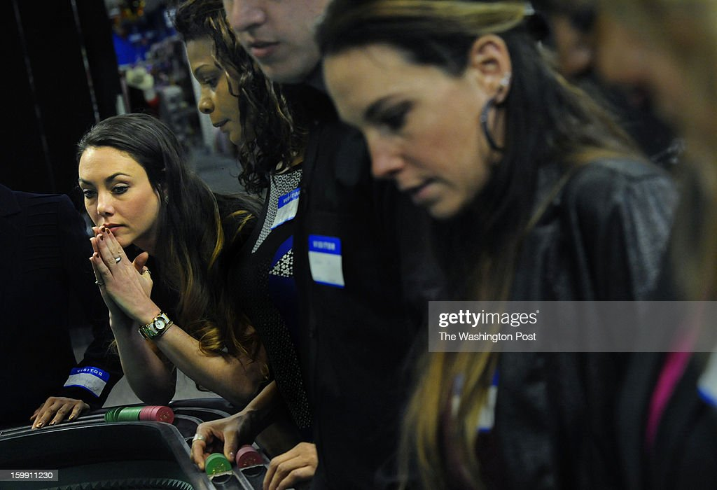 Maggie Neiss of Glen Burnie, MD watches the Craps table intensely as she soaks up knowledge of the game during a training session today. Students learn what it takes to be a dealer at the Maryland Live! Casino as they take lessons from professional dealers in hopes of landing a job. Photo by Michael S. Williamson/The Washington Post via Getty Images