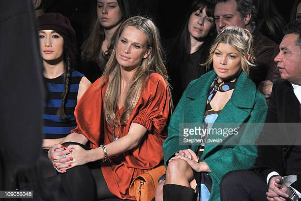 Maggie Q model Molly Sims and singer Fergie attend the Diane von Furstenberg Fall 2011 fashion show during MercedesBenz Fashion Week at The Theatre...