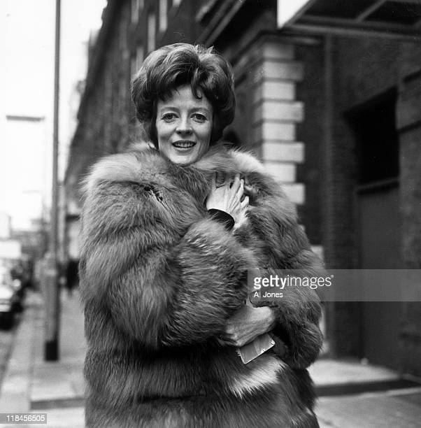 Maggie Smith British actress wearing a fur coat as she poses for a portrait in January 1969