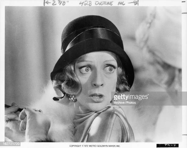 Maggie Smith looking to her left in a scene from the film 'Travels With My Aunt' 1972