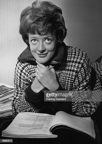 Maggie Smith reading a script shortly after she was named Stage Actress of the Year by the Variety Club of Great Britain