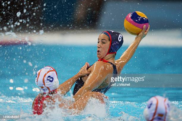Maggie Steffens of the USA is tackled by Pilar Pena Carrasco of Spain on Day 5 of the London 2012 Olympics at Water Polo Arena on August 1 2012 in...