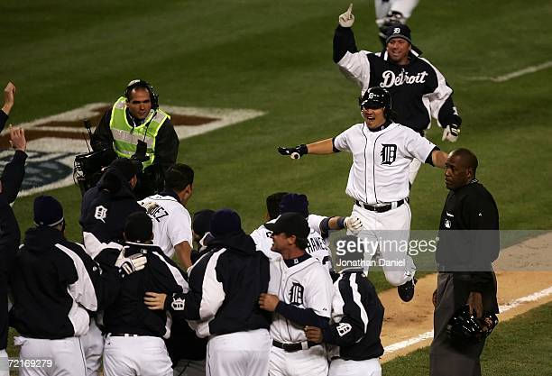 Magglio Ordonez of the Detroit Tigers runs to his teammates at home plate after he hit a 3run walkoff home run against Huston Street of the Oakland...