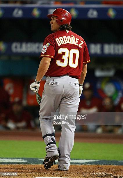 Magglio Ordonez of Venezuela walks back to the dugout after striking out in the second inning while taking on Puerto Rico during day 3 of round 2 of...