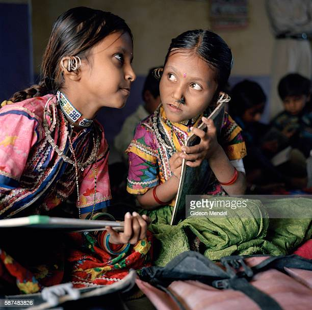 Maghas Ha Harijan and her sister Kavi Hira Harijan concerntrate on their schoolwork at the local school in Harijan Vas which has a total of 75 pupils...