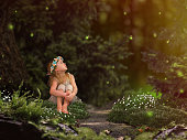 Magic fairy forest. A small child watching fireflies. A fairy tale for children