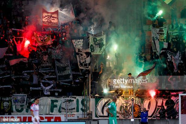 Magic Fans of Saint Etienne with bomb smokes during the Ligue 1 match between AS NancyLorraine and AS SaintEtienne at Stade Marcel Picot on May 20...