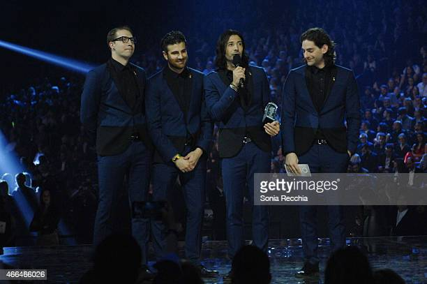 Magic is presented an award at the 2015 JUNO Awards at FirstOntario Centre on March 15 2015 in Hamilton Canada