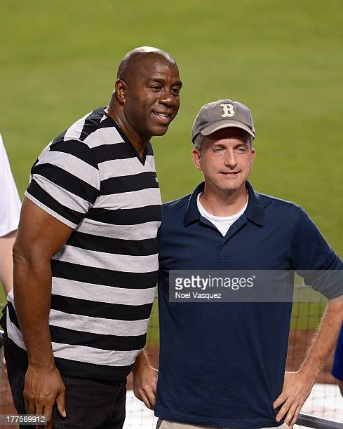 Magic Johnson and Bill Simmons attend a baseball game between the Boston Red Sox and Los Angeles Dodgers at Dodger Stadium on August 23 2013 in Los...