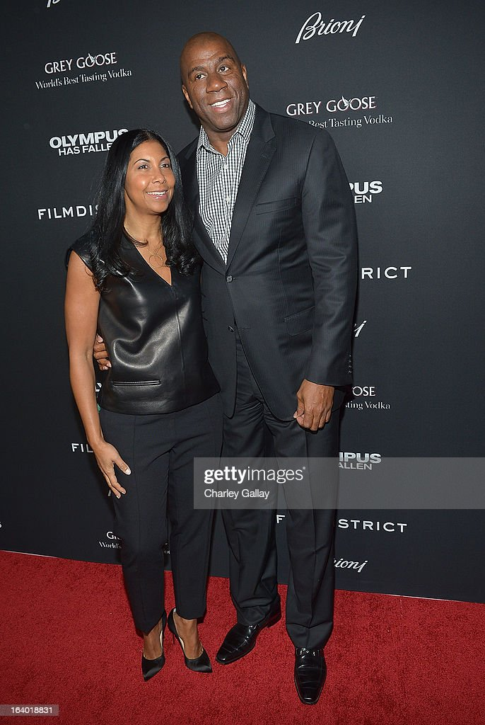 Magic Johnson and Cookie Johnson attend Brioni Sponsors Film District's World Premiere Of 'Olympus Has Fallen' ArcLight Cinemas on March 18, 2013 in Hollywood, California.