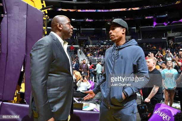 Magic Johnson and DeMar DeRozan of the Toronto Raptors talks during the game of the Los Angeles Sparks and the Washington Mystics on May 19 2017 at...