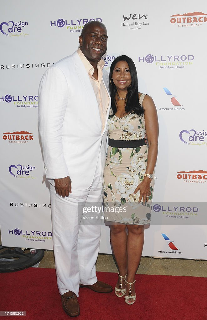 Magic Johnson and Earlitha 'Cookie' Kelly attend 15th Annual DesignCare on July 27, 2013 in Malibu, California.