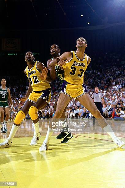 Magic Johnson and Kareem Abdul Jabbar of the Los Angeles Lakers wait for a rebound during a game against the Boston Celtics at the Forum in Los...