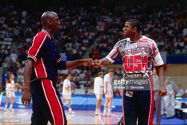 Magic Johnson and Michael Jordan of the United States high five each other against Lithuania during the 1992 Olympics on August 6 1992 at the Palau...