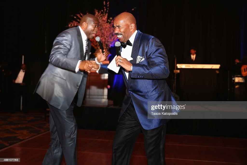 Magic Johnson and Steve Harvey speak at the 2014 Steve Marjorie Harvey Foundation Gala presented by CocaCola at the Hilton Chicago on May 3 2014 in...