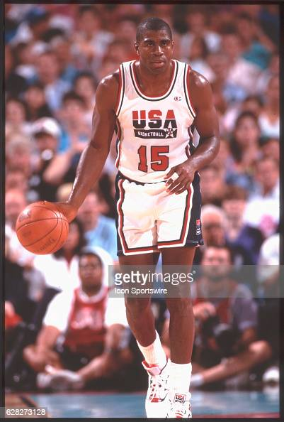 Magic Johnson of Team USA the Dream Team dribbles the ball during the men's basketball competition at the 1992 Summer Olympics in Barcelona Spain