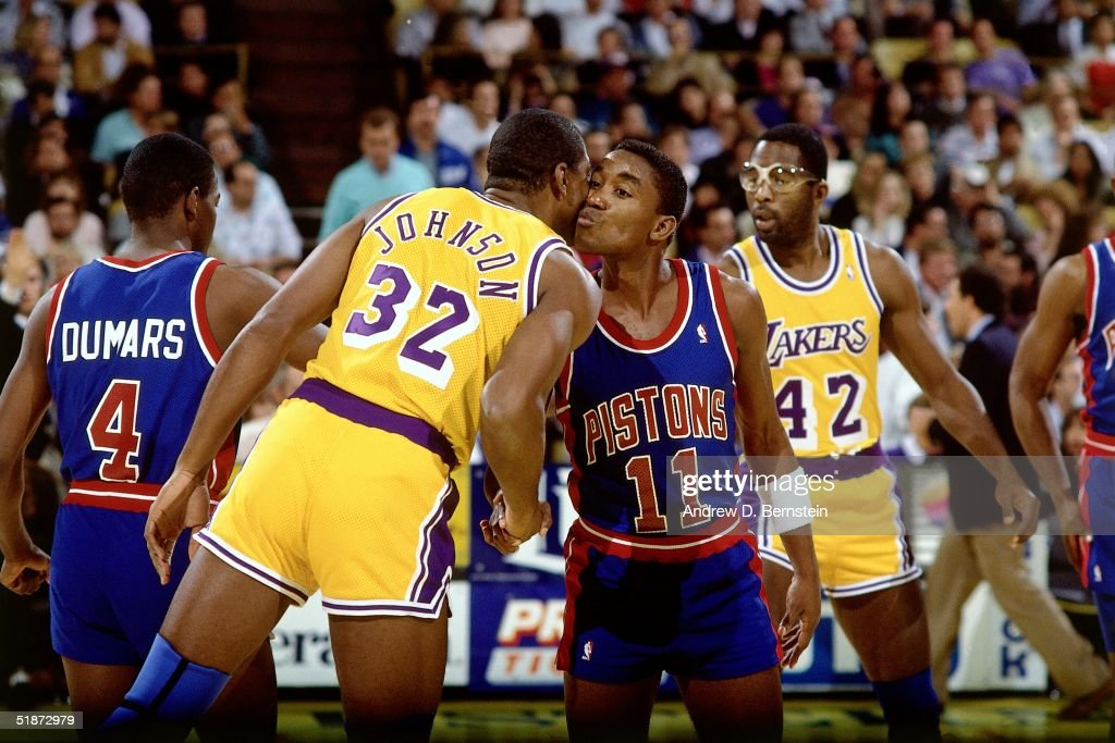 Magic Johnson #32 of the Los Angeles Lakers and Isiah Thomas #11 of the Detroit Pistons shake hands at center court prior to the NBA game at the Forum in Los Angeles, California.