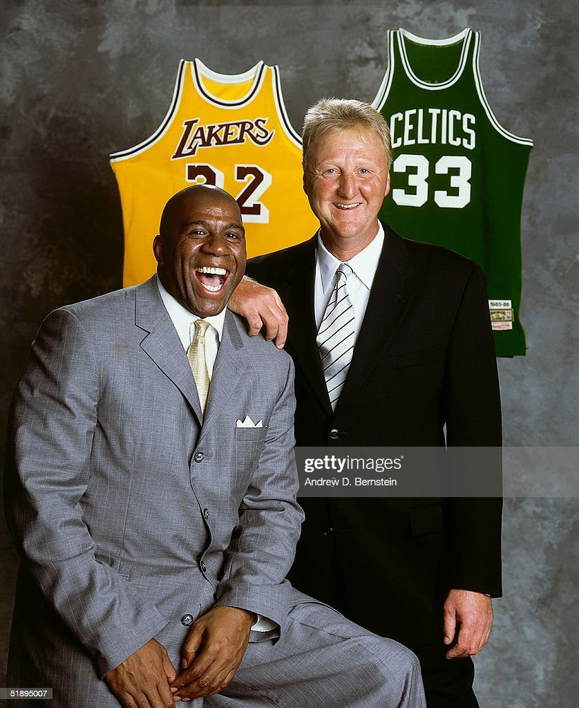 Magic Johnson #32 of the Los Angeles Lakers and Larry Bird #33 of the Boston Celtics pose for a portrait in Los Angeles, California.