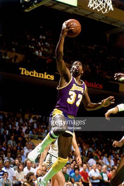 Magic Johnson of the Los Angeles Lakers attempts a layup during a 1984 NBA game NOTE TO USER User expressly acknowledges that by downloading and or...