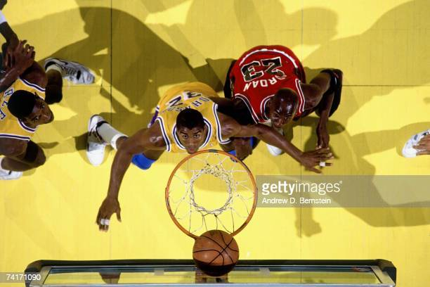 Magic Johnson of the Los Angeles Lakers battles for a rebound against Michael Jordan of the Chicago Bulls in the 1991 NBA Finals played at the Great...