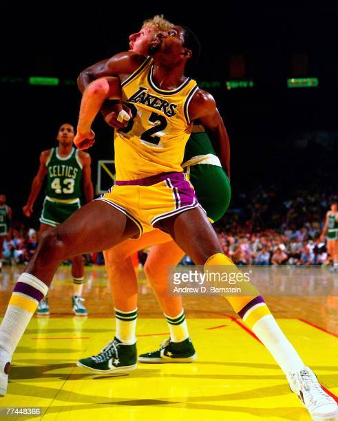 Magic Johnson of the Los Angeles Lakers battles for position against Larry Bird of the Boston Celtics during a game in 1983 at The Great Western...