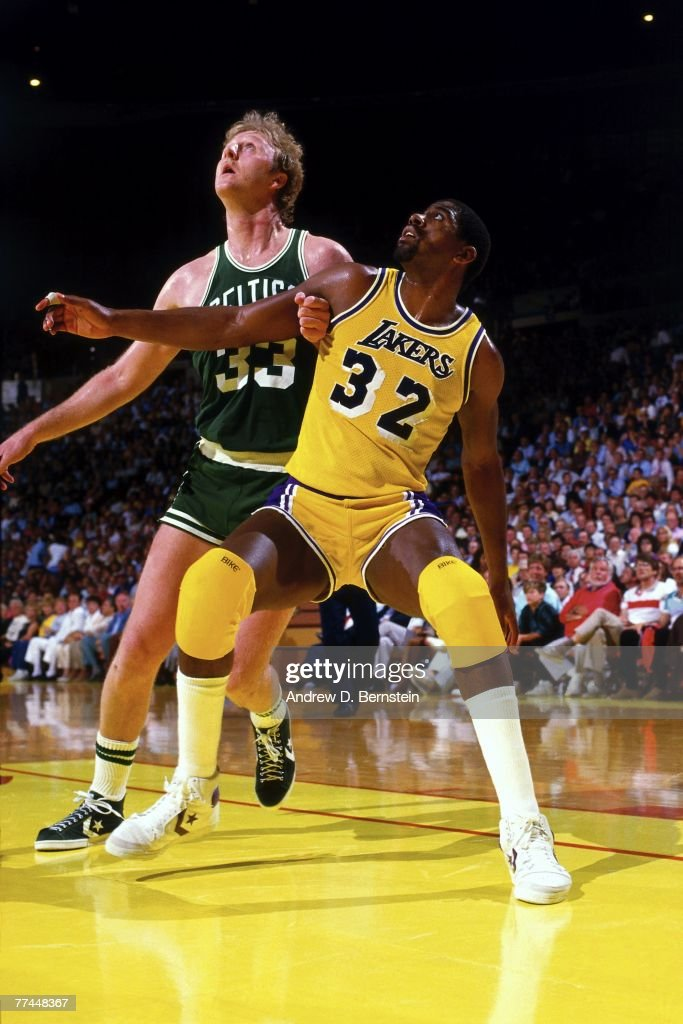 Magic Johnson of the Los Angeles Lakers battles for position against Larry Bird of the Boston Celtics during a game in 1984 at The Great Western...