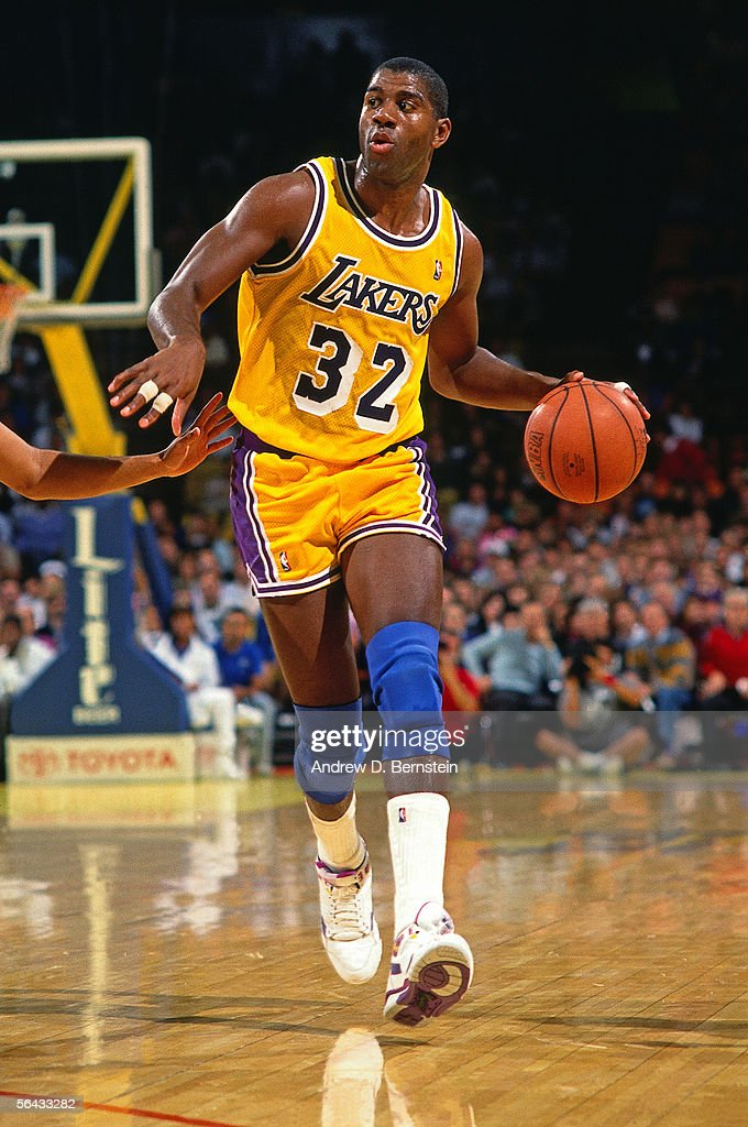 Magic Johnson of the Los Angeles Lakers dribble drives to th ebasket during the NBA game at the Forum circa 1991 in Inglewood California NOTE TO USER...