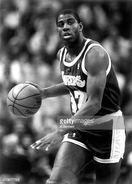Magic Johnson of the Los Angeles Lakers dribbles down the court during an NBA game circa 1988