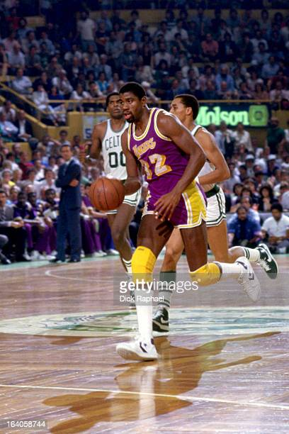 Magic Johnson of the Los Angeles Lakers dribbles the ball against the Boston Celtics during a game played circa 1980 at the Boston Garden in Boston...