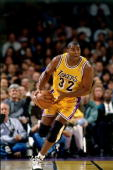 Magic Johnson of the Los Angeles Lakers dribbles the ball upcourt against the Utah Jazz during an NBA game at the Staples Center on February 41996 in...