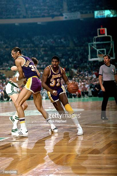 Magic Johnson of the Los Angeles Lakers drives to the basket against Kevin McHale of the Boston Celtics during a 1984 NBA game at Boston Garden in...