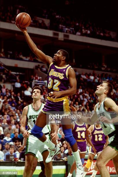 Magic Johnson of the Los Angeles Lakers goes for a layup against the Milwaukee Bucks during the NBA game in Milwaukee Wisconsin NOTE TO USER User...