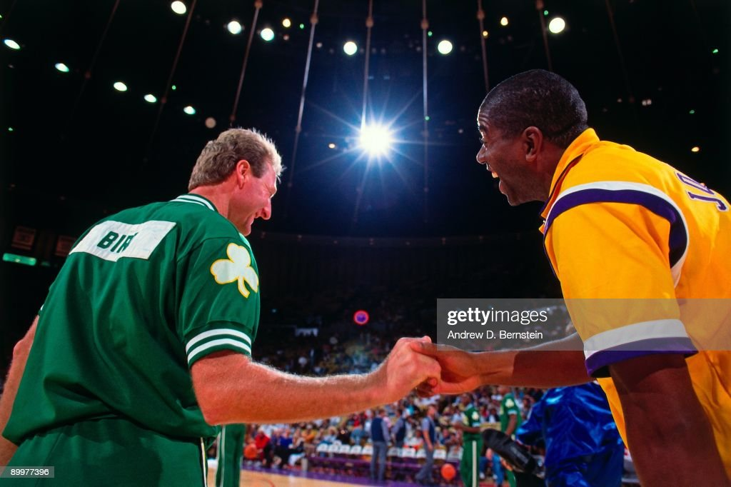 Magic Johnson #32 of the Los Angeles Lakers greets Larry Bird #33 of the Boston Celtics prior to the games during the 1991 NBA season at The Great Western Forum in Inglewood, California.