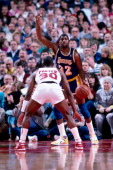 Magic Johnson of the Los Angeles Lakers looks to dribble past Terry Porter of the Portland Trail Blazers during a game played circa 1987 at the...