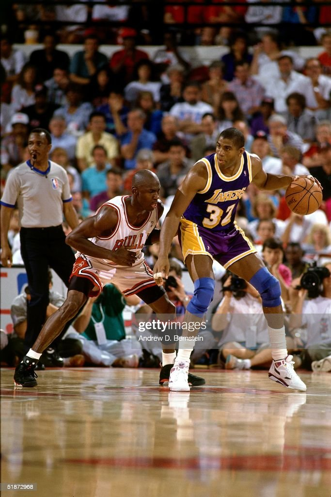 Magic Johnson of the Los Angeles Lakers looks to make a play against Michael Jordan of the Chicago Bulls during the NBA game in Chicago Illinois NOTE...