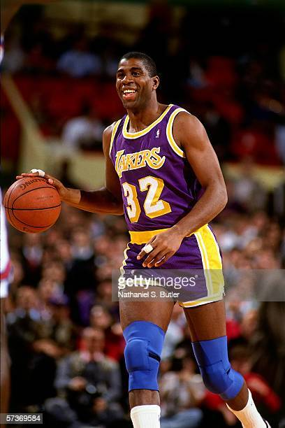 Magic Johnson of the Los Angeles Lakers moves the ball up court during a game against the New York Knicks circa 1990 at Madison Square Garden in New...
