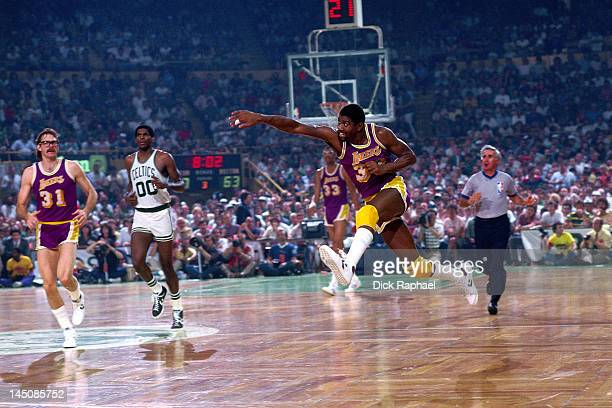 Magic Johnson of the Los Angeles Lakers passes against the Boston Celtics circa 1985 at the Boston Garden in Boston Massachussetts NOTE TO USER User...