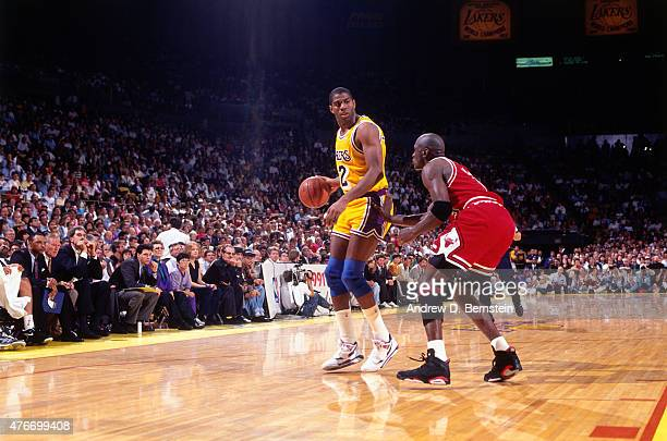 Magic Johnson of the Los Angeles Lakers post up against Michael Jordan of the Chicago Bulls during Game Five of the 1991 NBA Finals on June 12 1991...