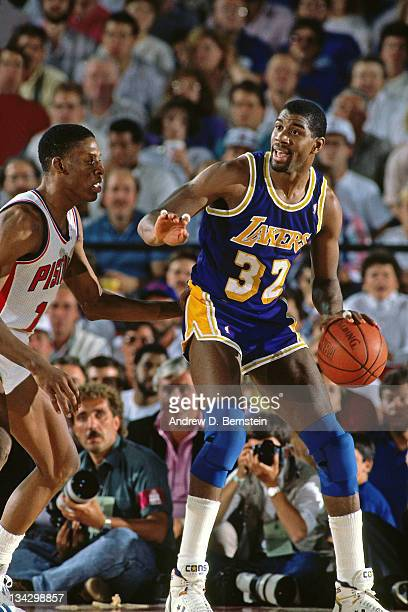 Magic Johnson of the Los Angeles Lakers posts up against Dennis Rodman of the Detroit Pistons during Game Five of the 1988 NBA Finals on June 16 1988...
