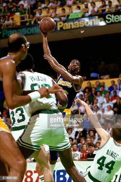 Magic Johnson of the Los Angeles Lakers scores the game winning hookshot against the Boston Celtics during Game Four of the 1987 NBA Finals on June 9...