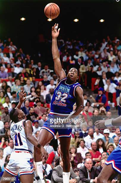 Magic Johnson of the Los Angeles Lakers shoots a hook shot over Isiah Thomas of the Detroit Pistons of the East AllStars during the 1992 NBA AllStar...