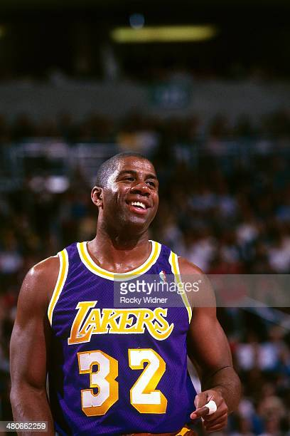 Magic Johnson of the Los Angeles Lakers smiles circa 1996 at Key Arena in Seattle Washington NOTE TO USER User expressly acknowledges and agrees that...