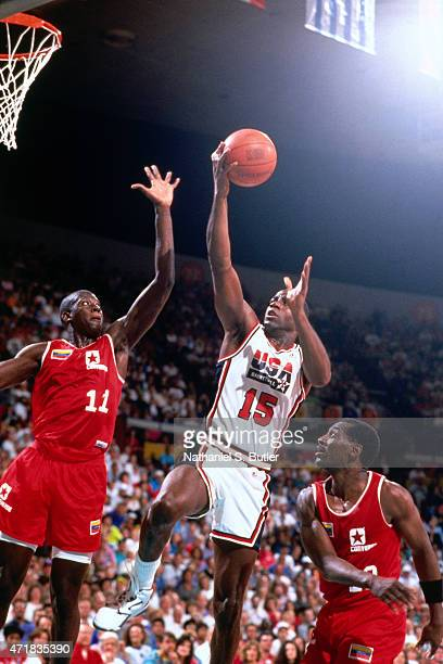 Magic Johnson of the United States shoots against Venezuela circa 1992 in the 1992 Summer Olympics at Palau Municipal d'Esports de Badalona in...