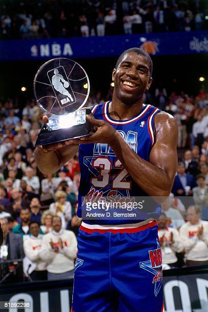 Magic Johnson of the Western Conference AllStars holds the MVP trophy following the 1992 NBA All Star Game on February 9 1992 at the Orlando Arena in...